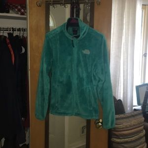 Turquoise north face fuzzy fleece zip up
